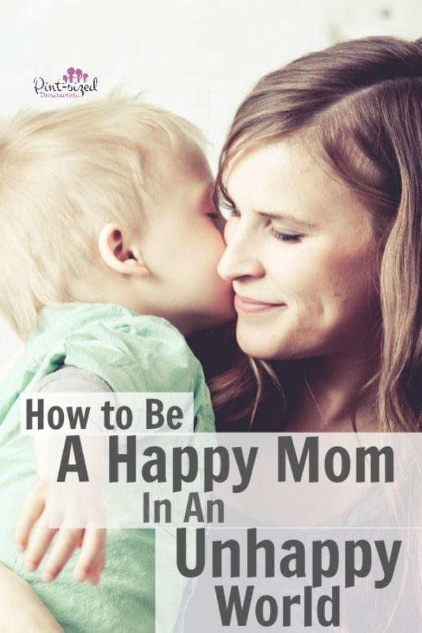 happy mom holding her child