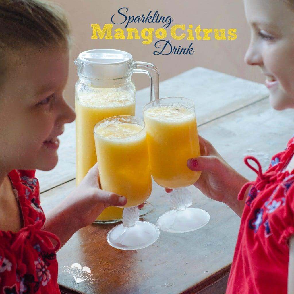 sparkling mango orange drink in glasses