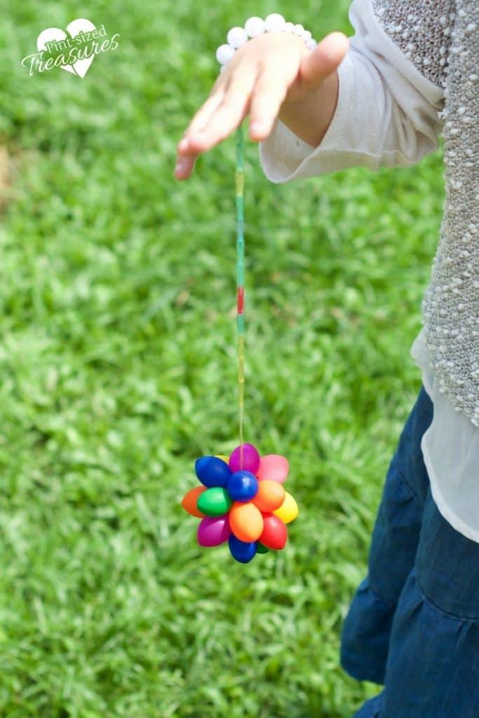 rainbow loom string added to rainbow sensory balloon balls