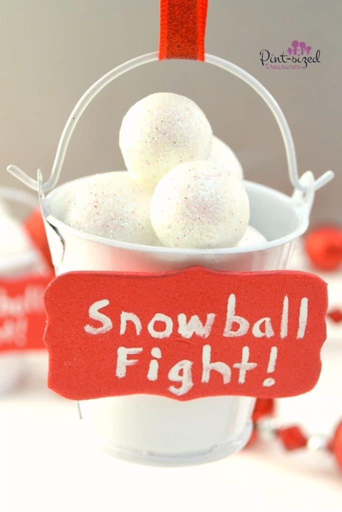 Super-cute! These easy DIY Snowball Fight Christmas Ornaments are super creative and unique! Kids can even make these -- with adult supervision. Too cute to miss! Can't wait to hang these snowball fight ornaments on my Christmas tree!