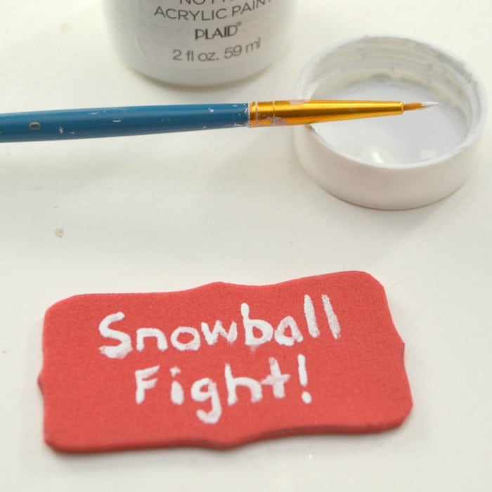 painting the DIY snowball fight Christmas ornament
