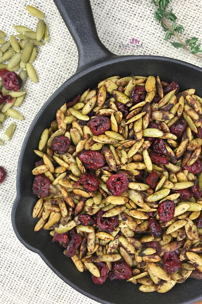 Oooh! These toasted pumpkin seeds with cranberries are a healthy, but indulgent snack for the  holidays! It's perfectly spiced with your fave holiday spices and toasted to perfection. Enjoy pumpkin seeds in a whole new way!