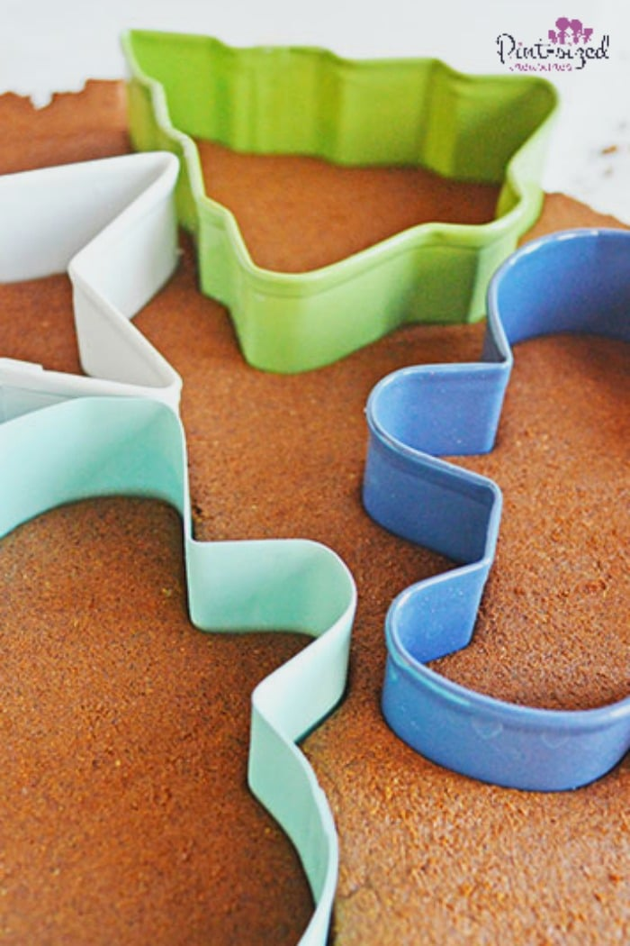 making cinnamon gingerbread men ornaments