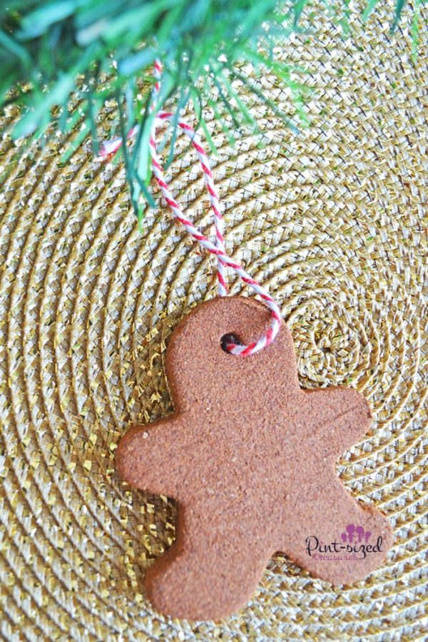 These cinnamon gingerbread ornaments are so easy to make! With just a few ingredients, you're home will smell and look amazing! A fun Christmas activity that kids and parents love! #DIYOrnaments #Christmasdecor #EasyChristmasCraft
