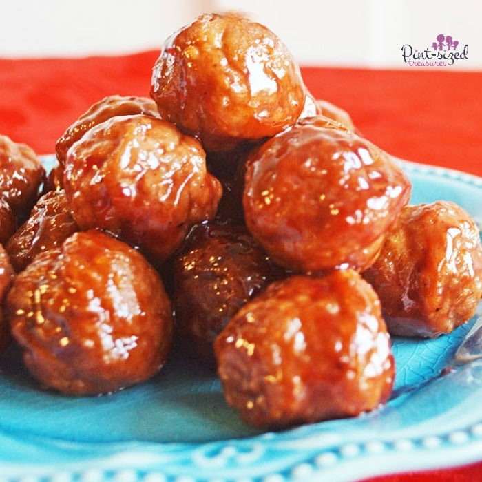 Easy, Slow Cooker Sweet and Spicy Meatballs make every party more fun! They're a cinch to make and taste amazing! Add this recipe to your easy holiday recipe list! #slowcookerrecipe #easymeatballs #spicymeatballs #sweetandspicymeatballs #appetizerrecipe