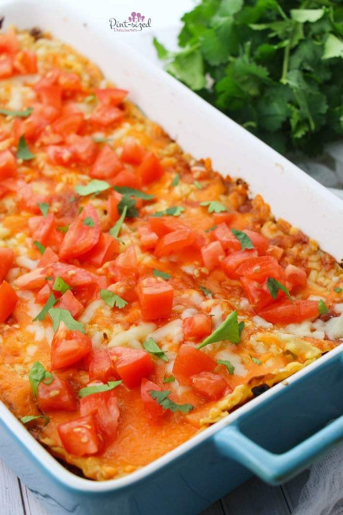 Our easiest taco lasagna bake recipe is hot from the oven and ready to eat! Print out the recipe!