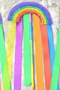 Super simple rainbow wands are made with thick paper, ribbons and paint! Super simple craft forbids who love rainbows! #rainbowcraft #rainbowwand #pretendplay #wandcraft #StPatricksDay #craftsforkids #easyrainbowcraftsforkids