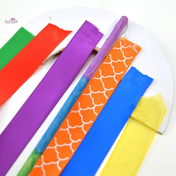 gluing ribbons on paper rainbow