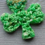 Totally easy Shamrock Rice Krispie Treats are perfect for St. Patrick's Day celebrations! They're super simple, crazy yummy and completely cute! #StPatricksDay #ricekrispietreats #shamrocktreats #shamrocks #easytreats #StPattysDayTreats #greenfood