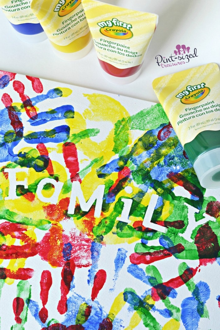 The kids will LOVE thees easy, handprint canvases! Super simple craft for preschoolers and toddlers!