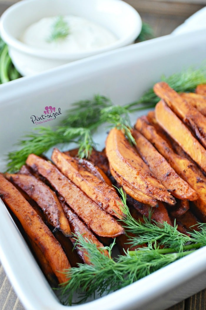 Easy sweet potato fries are baked, seasoned and SPICY! #bakedsweetpotatoes #sweetpotatofries #sweetpotatoes #bakedfries #easysides #easyrecipes #bestrecipes #homemadefries