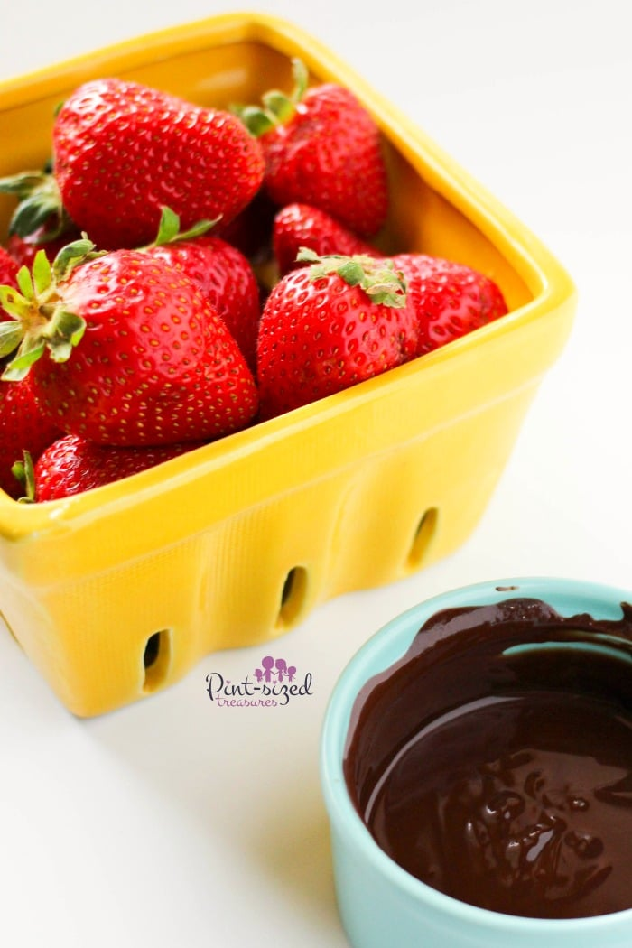 Dipping strawberries in chocolate