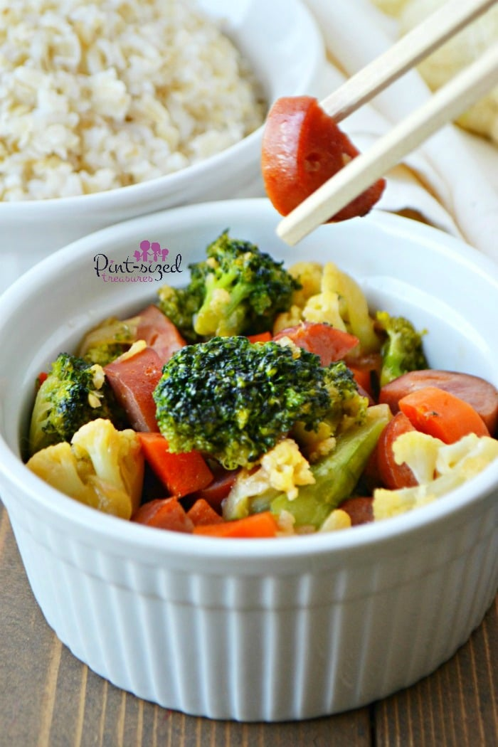 Make this super simple, Sausage and veggie stir-fry recipe for a hearty, easy and yummy meal! Made with fresh veggies and our favorite sausage, it's perfect for busy families and even dinner guests! Grab your chopsticks!