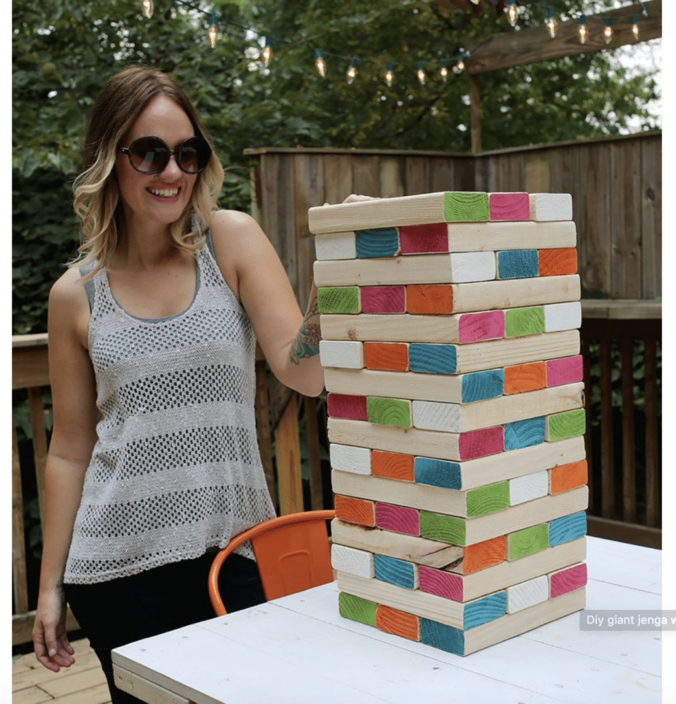playing an outdoor game called Jenga