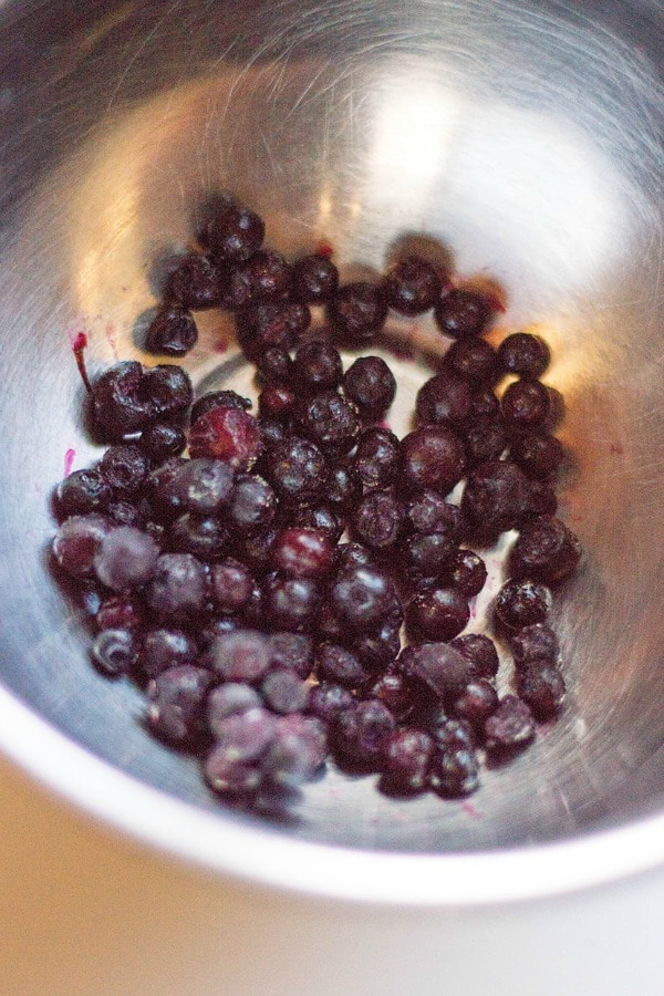 prepping blueberries for muffins