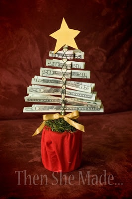 rolling cash into a money tree for a fun gift idea