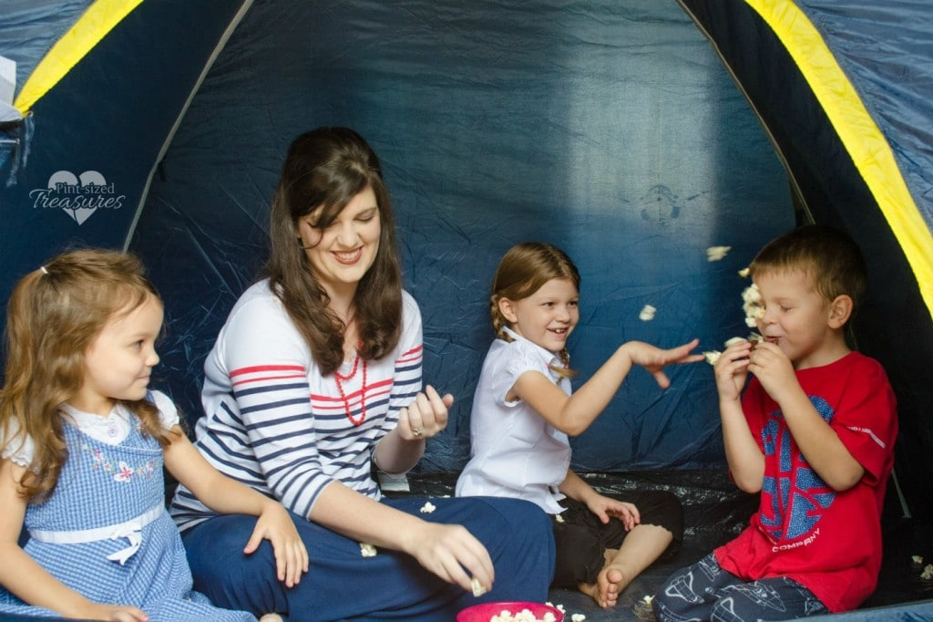 playing in a tent for a non toy gift idea for kids