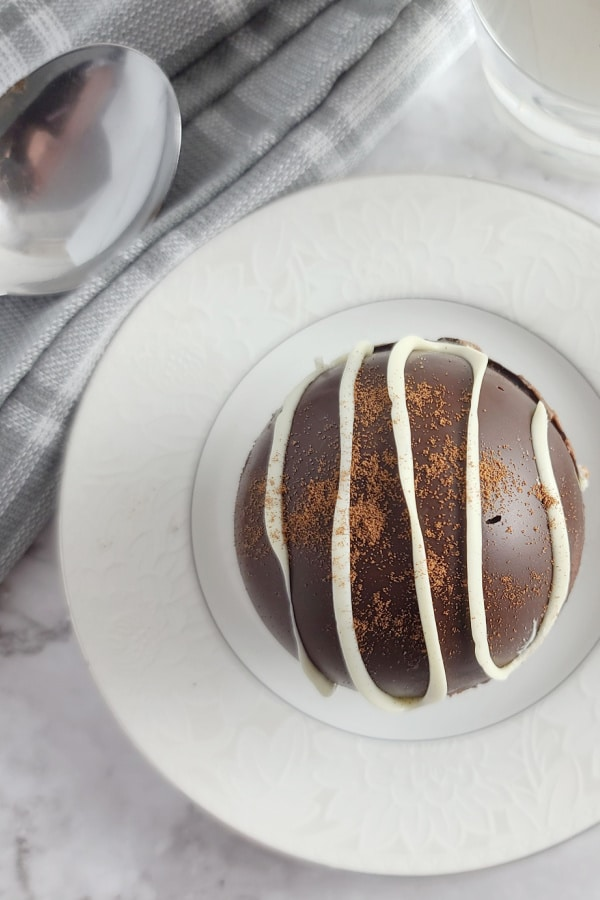 mocha hot chocolate bomb on white plate