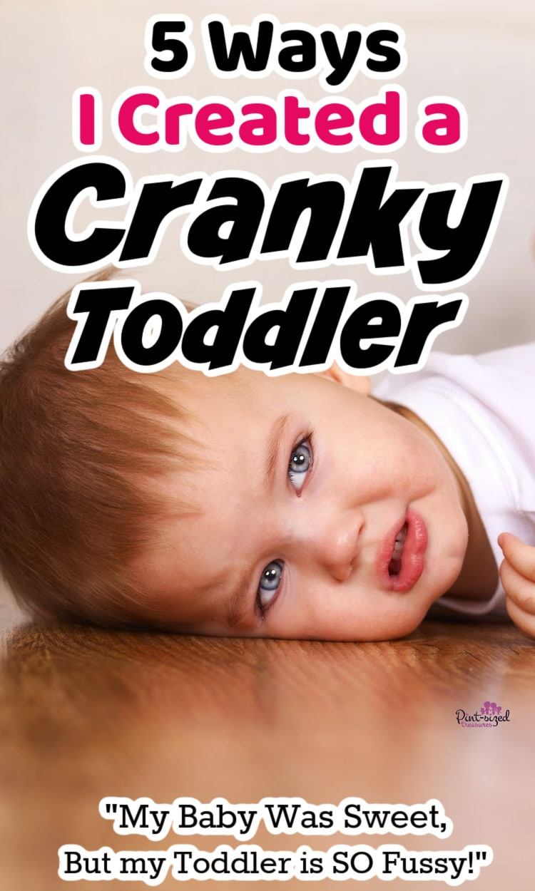 cranky toddler crying on floor