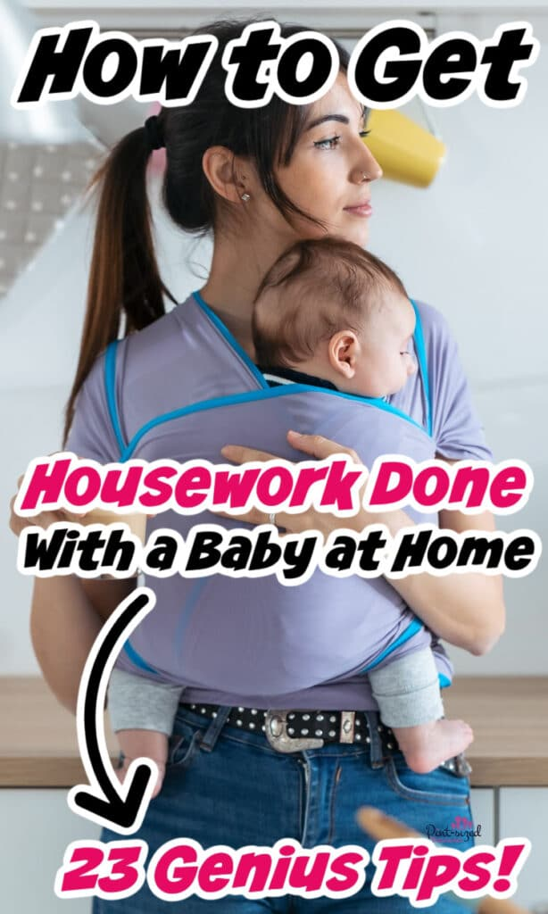 mom holding her baby as she cleans the house