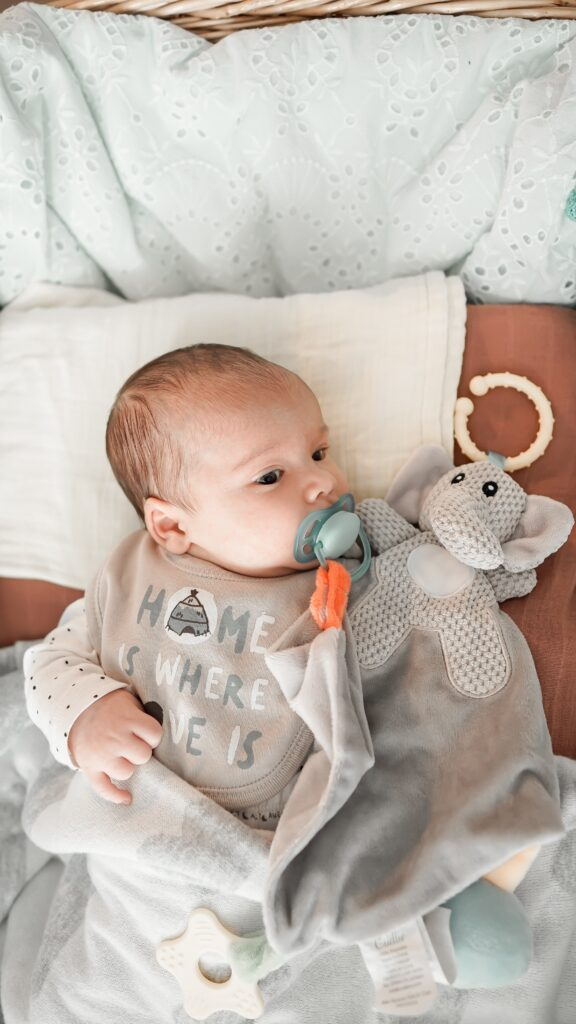 baby with a pacifier at baby shower