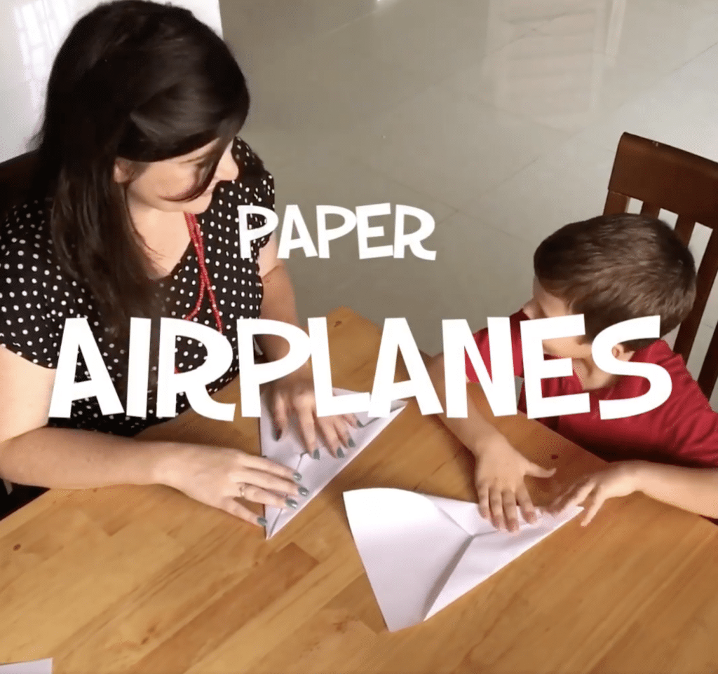 making paper airplanes with kids for a fun kids activity
