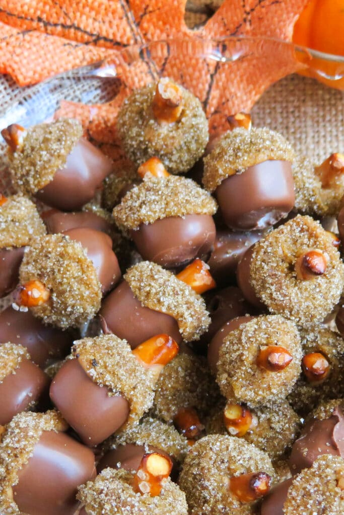 chocolate dipped fall acorn treats on serving platter