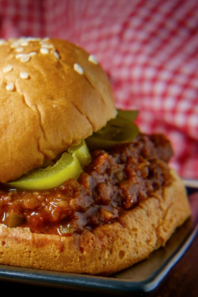sloppy joes with pickles on a bun